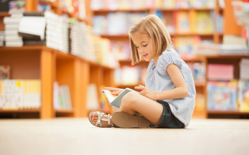 A girl reads in a library.