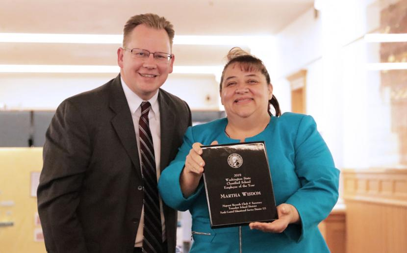 Superintendent Reykdal and Classified School Employee of the Year Martha Wisdom pose for a photo