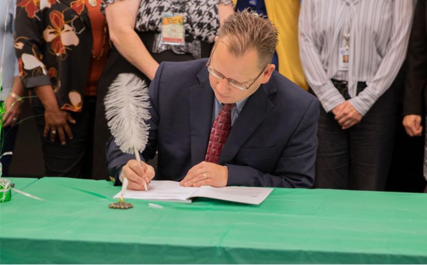 Superintendent Reykdal signs the Social Studies K-12 Learning Standards
